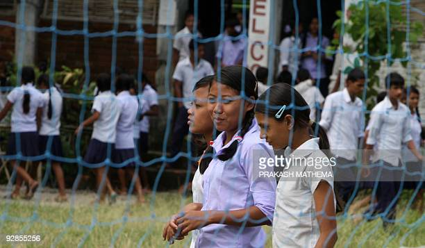 Bhutanese refugees students relax during a break from studies at The Oasis Academy at The Timai Refugee Camp some 300kms southeast of Kathmandu on...