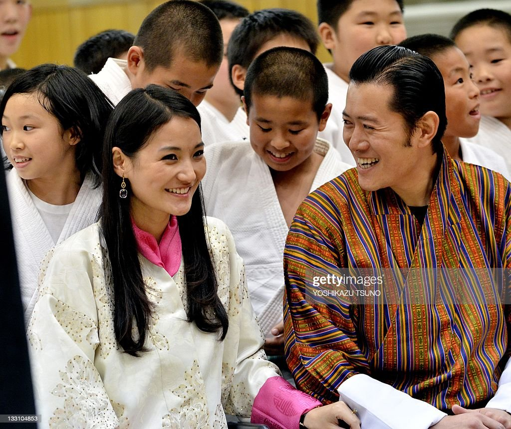 Bhutan's King <a gi-track='captionPersonalityLinkClicked' href=/galleries/search?phrase=Jigme+Khesar+Namgyel+Wangchuck&family=editorial&specificpeople=737466 ng-click='$event.stopPropagation()'>Jigme Khesar Namgyel Wangchuck</a> (centre R) and Queen Jetsun Pema (centre L) smile as they are surrounded by young judo players after inspecting a judo training session at Tokyo's Kodokan judo gymnasium on November 17, 2011. Bhutan's royal couple are on a six-day visit to Japan as state guests. AFP PHOTO / Yoshikazu TSUNO