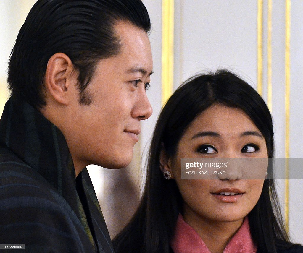 Bhutan's King <a gi-track='captionPersonalityLinkClicked' href=/galleries/search?phrase=Jigme+Khesar+Namgyel+Wangchuck&family=editorial&specificpeople=737466 ng-click='$event.stopPropagation()'>Jigme Khesar Namgyel Wangchuck</a> (L) smiles with Queen Jetsun Pema (R) as they wait for Japanese Prime Minister Yoshihiko Noda for their talks at the Akasaka guesthouse in Tokyo on November 15, 2011. Bhutan's royal couple are now here on a six-day visit to Japan as the state guests. AFP PHOTO / POOL / Yoshikazu TSUNO
