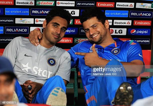 Bhuvneshwar Kumar and Suresh Raina of India look on from the dug out during the ICC World Twenty20 Bangladesh 2014 match between Bangladesh and India...