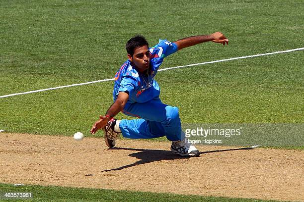 Bhuvneshwar Kumar of India attempts to field off his own bowling during the first One Day International match between New Zealand and India at McLean...