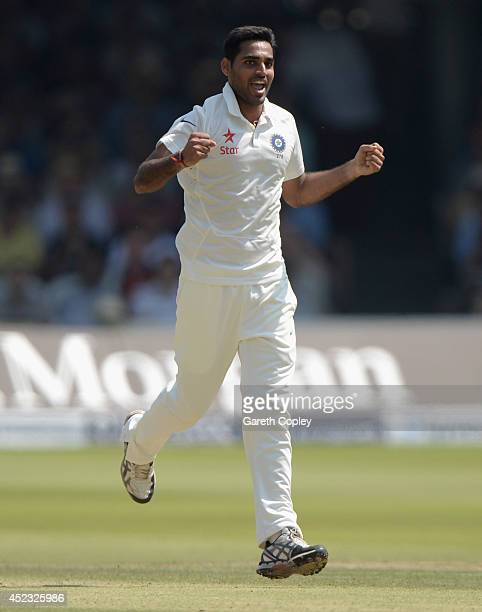 Bhuvneshwar Kumar of India celebrates dismissing England captain Alastair Cook during day two of 2nd Investec Test match between England and India at...