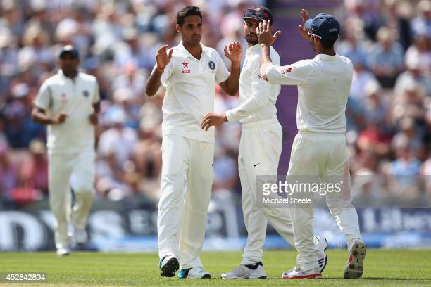 Bhuvneshwar Kumar of India celebrates taking the wicket of Joe Root of England during day two of the 3rd Investec Test match between England and...
