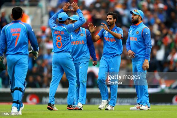 Bhuvneshwar Kumar of India celebrates the wicket of Kusal Mendis of Sri Lanka during the ICC Champions trophy cricket match between India and Sri...