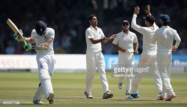 Bhuvneshwar Kumar of India celebrates with teammates after dismissing Sam Robson of England during day two of 2nd Investec Test match between England...
