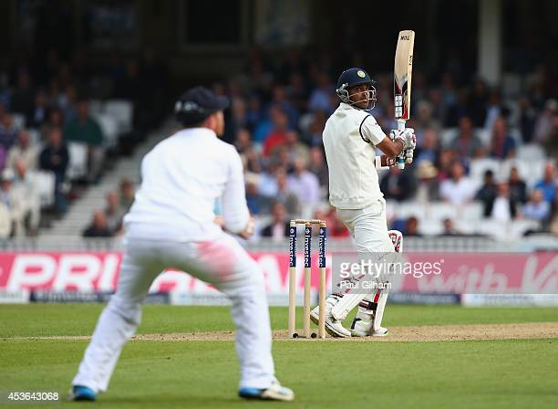 Bhuvneshwar Kumar of India hits out during day one of the 5th Investec Test match between England and India at The Kia Oval on August 15 2014 in...