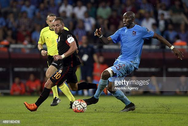 Bia of Trabzonspor is in action against Wesley Sneijder of Galatasaray during a Turkish Spor Toto Super League soccer match between Trabzonspor and...