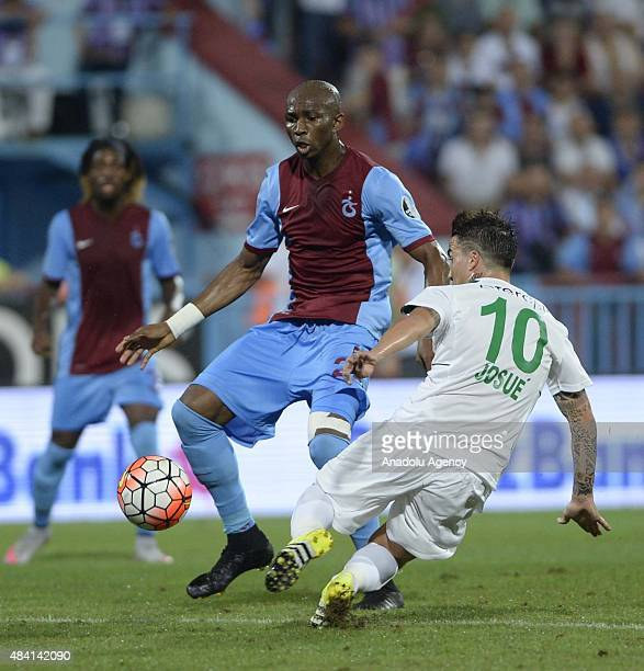 M'bia of Trabzonspor vies with his opponent during Turkish Spor Toto Super League soccer match between Trabzonspor and Bursaspor at Huseyin Avni Aker...