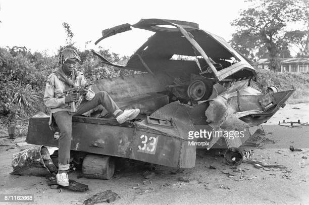A Biafran soldier seen here sitting on a destroyed Nigerian army armoured personnel carrier 11th June 1968