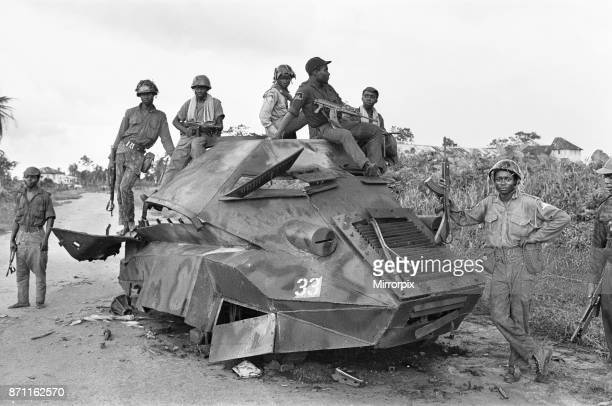 A Biafran soldiers seen here sitting on a destroyed Nigerian army armoured personnel carrier 11th June 1968
