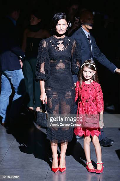 Bianca Balti and her daughter Matilde attend the Dolce Gabbana show as part of Milan Fashion Week Womenswear Spring/Summer 2014 at on September 22...