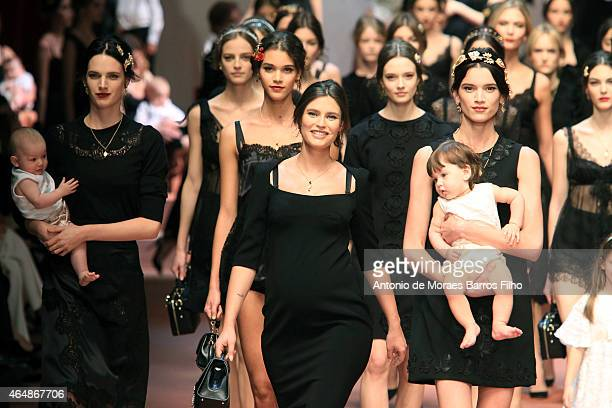 Bianca Balti and models walk the runway at the Dolce Gabbana show during the Milan Fashion Week Autumn/Winter 2015 on March 1 2015 in Milan Italy