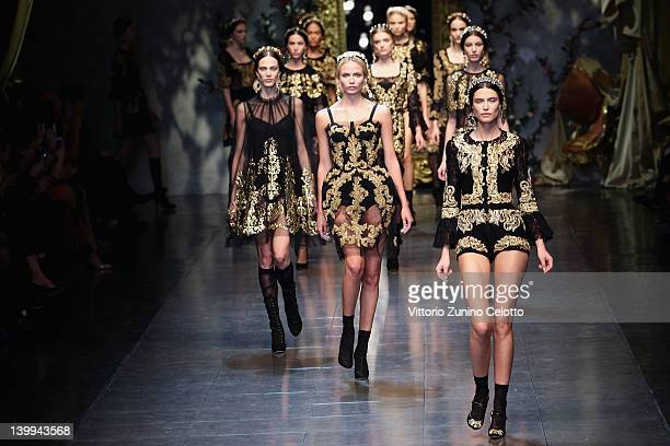 Bianca Balti and Natasha Poly walk the runway at the Dolce Gabbana Autumn/Winter 2012/2013 fashion show as part of Milan Womenswear Fashion Week on...