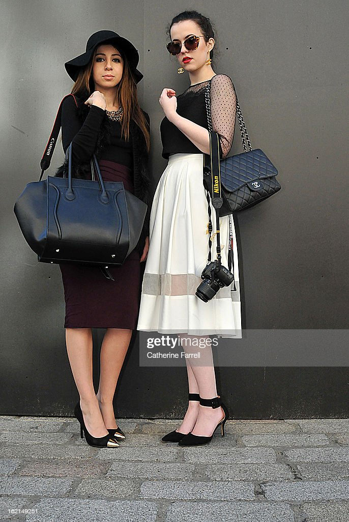 Bianca Bass and Arabella Golby Bianca Bass, a lifestyle writer and blogger wearing a Zara top and pencil slim skirt with vintage shoes and Celine bag and vintage necklace from Brick Lane, while Arabella Golby a Student at Oxford University is wearing a monochromatic look comprising a shower of hail top from Topshop, cream skirt with inset organza panel, accessorised with Miu Miu sunglasses,Chanel earrings ( present from her grandmother), Chanel bag and Zara shoes at London Fashion Week Fall/Winter 2013/14 on February 19, 2013 in London, England.