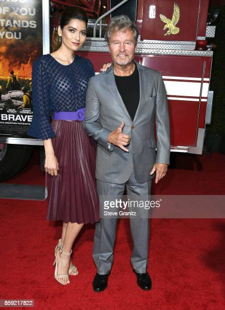 Bianca BlancoJohn Savage arrives at the Premiere Of Columbia Pictures' 'Only The Brave' at Regency Village Theatre on October 8 2017 in Westwood...