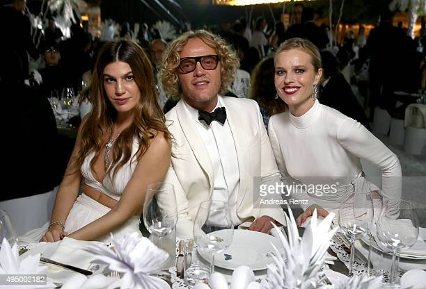 Bianca Brandolini d'Adda Peter Dundas and Eva Herzigova attend the Gala event during the Vogue Fashion Dubai Experience 2015 at Armani Hotel Dubai on...