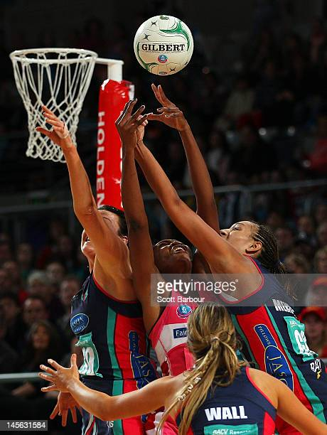 Bianca Chatfield and Geva Mentor of the Vixens compete for the ball with Carla Borrego of the Thunderbirds during the round 10 ANZ Championship match...