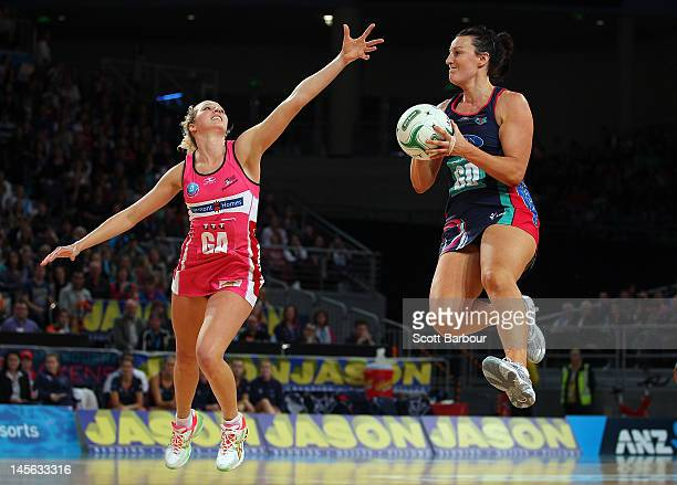 Bianca Chatfield of the Vixens competes for the ball with Erin Bell of the Thunderbirds during the round 10 ANZ Championship match between the Vixens...