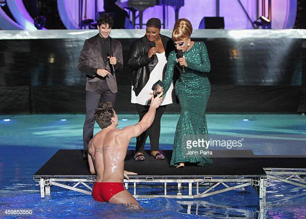 Bianca Del Rio accepts an award onstage with Host Darren Criss and Nicole Byer beside her at Logo TV's 2014 NewNowNext Awards at the Kimpton...