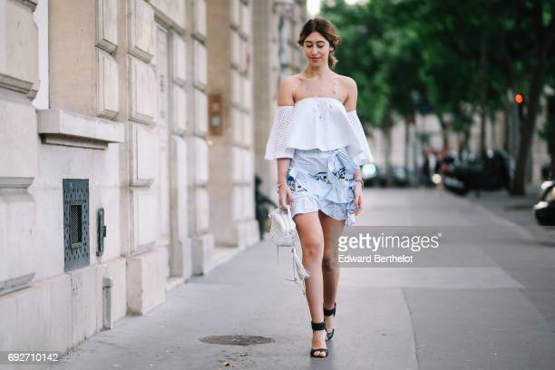 Bianca Derhy fashion blogger Bibi Goes Chic wears a Revolve off shoulder lace top a Shein blue ruffled flower print skirt a Furla bag and black shoes...