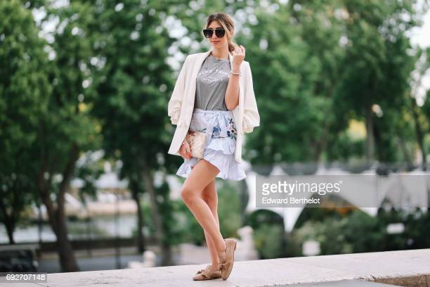 Bianca Derhy fashion blogger Bibi Goes Chic wears a Shein flower print skirt a River Island gray top with the inscription 'Saint Tropez' a Zara...