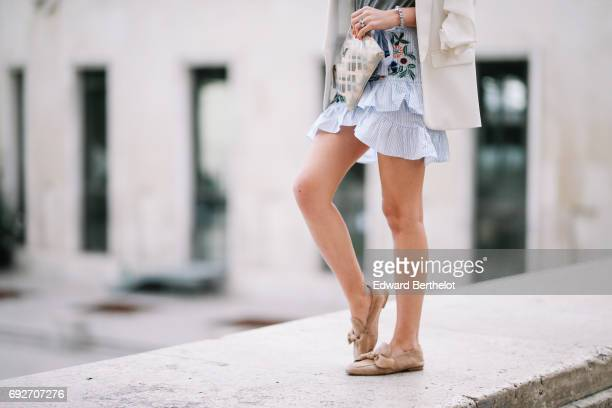 Bianca Derhy fashion blogger Bibi Goes Chic wears a Shein flower print skirt a River Island gray top with the inscription 'Saint Tropez' a Zara...