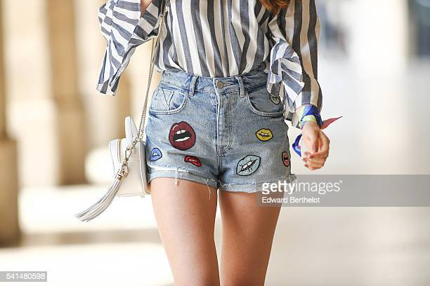 Bianca Derhy is wearing a Glamorous striped top Zara shorts Tory Burch shoes and a Furla bag during a street style session on June 19 2016 in Paris