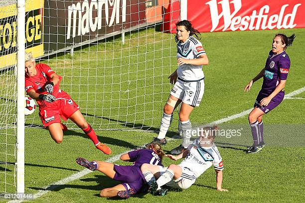 Bianca Henninger of the Victory attempts to save a shot by Alyssa Mautz of the Glory during the round 11 WLeague match between the Perth Glory and...