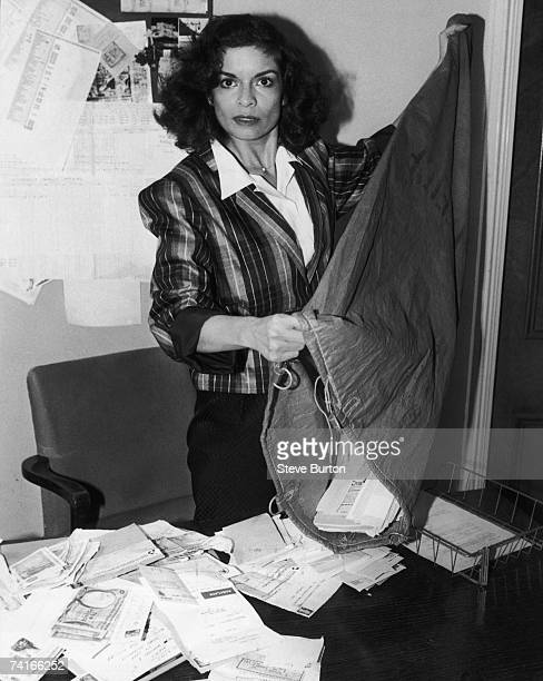 Bianca Jagger empties a sack of donations at the headquarters of the British Red Cross Society in Grosvenor Crescent London 19th July 1979 The...
