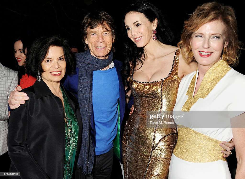 Bianca Jagger, Mick Jagger, L'Wren Scott and Julia Peyton-Jones attend the annual Serpentine Gallery Summer Party co-hosted by L'Wren Scott at The Serpentine Gallery on June 26, 2013 in London, England.