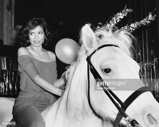 Bianca Jagger rides in on a white horse at during her birthday celebrations at Studio 54 in New York May 1977