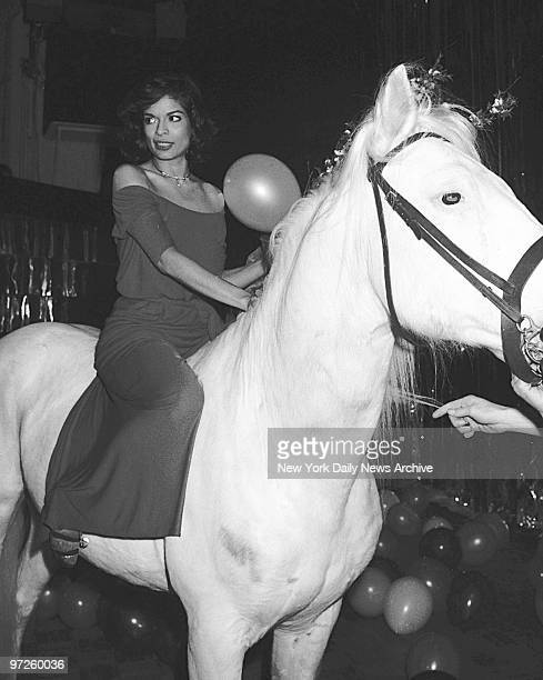 Bianca Jagger the birthday girl straddles an equine visitor to her birthday bash at Studio 54