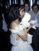 Bianca Jagger wearing Halston Halston and Liza Minnelli attend Halston Party for Bianca Jagger on December 12 1977 at Studio 54 in New York City