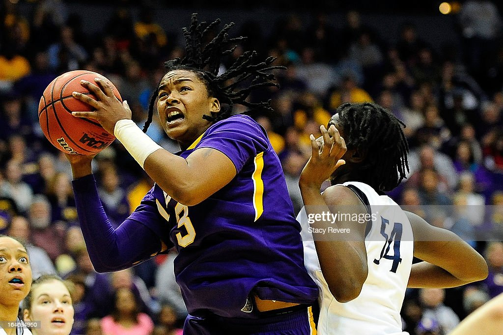 Bianca Lutley #3 of the LSU Tigers drives in front of Nikki Greene #54 of the Penn State Lady Lions during the second round of the NCAA Tournament at the Pete Maravich Assembly Center on March 26, 2013 in Baton Rouge, Louisiana.