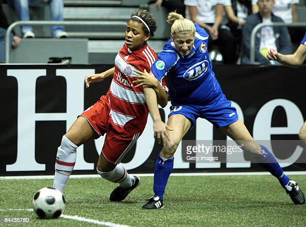 Bianca Schmidt of 1 FFC Turbine Potsdam in action against Sylvie Banecki of FC Bayern Muenchen during the THome DFB Indoor Cup at the Boerdelandhalle...