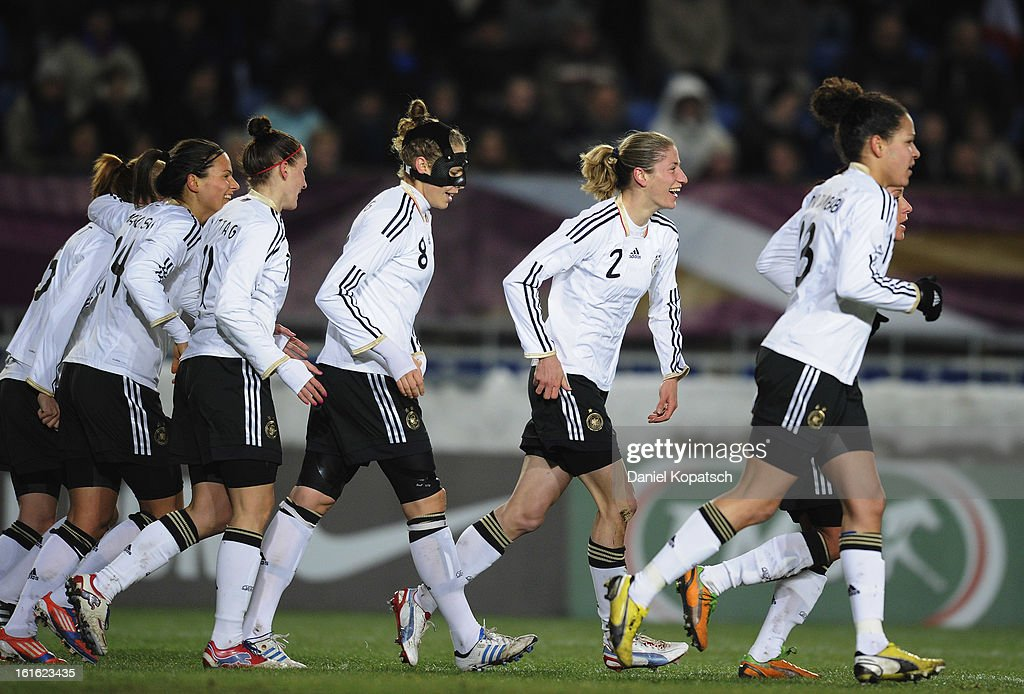 Bianca Schmidt of Germany (C) celebrates her team's first goal with team-mates during the international friendly match between France and Germany at Stade de la Meinau on February 13, 2013 in Strasbourg, France.