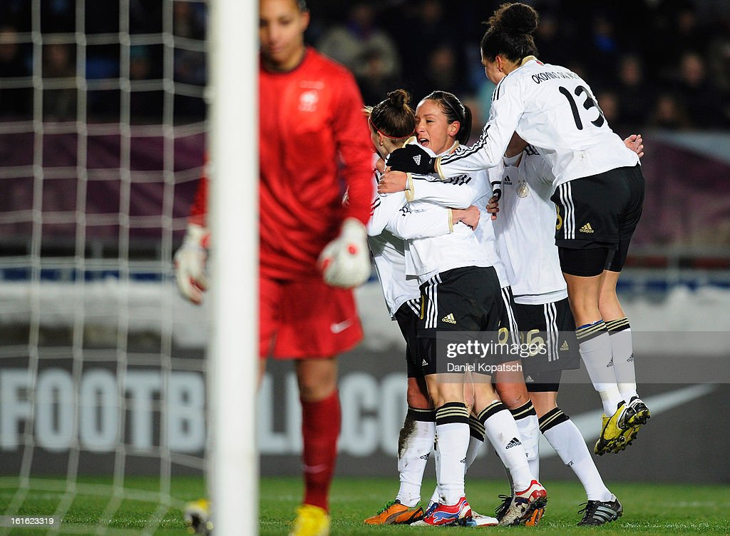 Bianca Schmidt of Germany (hidden) celebrates with her team-mates after scoring their fist goal during the international friendly match between France and Germany at Stade de la Meinau on February 13, 2013 in Strasbourg, France.