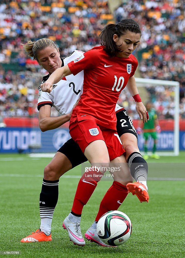 Bianca Schmidt of Germany challenges Karen Carney of England during the FIFA Women's World Cup 2015 Third Place Play-off match between Germany and England at Commonwealth Stadium on July 4, 2015 in Edmonton, Canada.