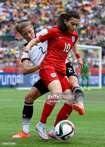 Bianca Schmidt of Germany challenges Karen Carney of England during the FIFA Women's World Cup 2015 Third Place Playoff match between Germany and...