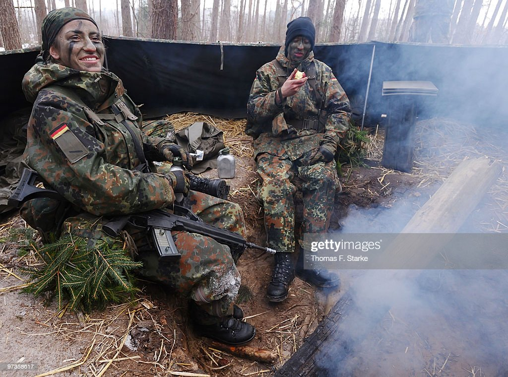 Bianca Schmidt (L) smiles during a basic military service drill at the Clausewitz barrack on February 9, 2010 in Nienburg, Germany. German women's national player Bianca Schmidt fulfills her basic military service before moving to a 'Sportfoerdergruppe' of the German armed forces.