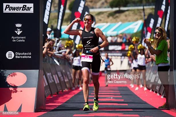 Bianca Steurerr of Austria celebrates as she finishes in 3rd place Ironman 703 Barcelona race on May 22 2016 in Barcelona Spain
