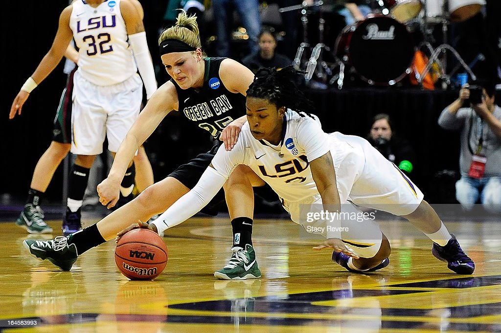 Bianca Utley #3 of the LSU Tigers and Jenny Gilbertson #25 of the Green Bay Phoenix dive for a loose ball during the first round of the NCAA Tournament at the Pete Maravich Assembly Center on March 24, 2013 in Baton Rouge, Louisiana. LSU won the game 75-71.