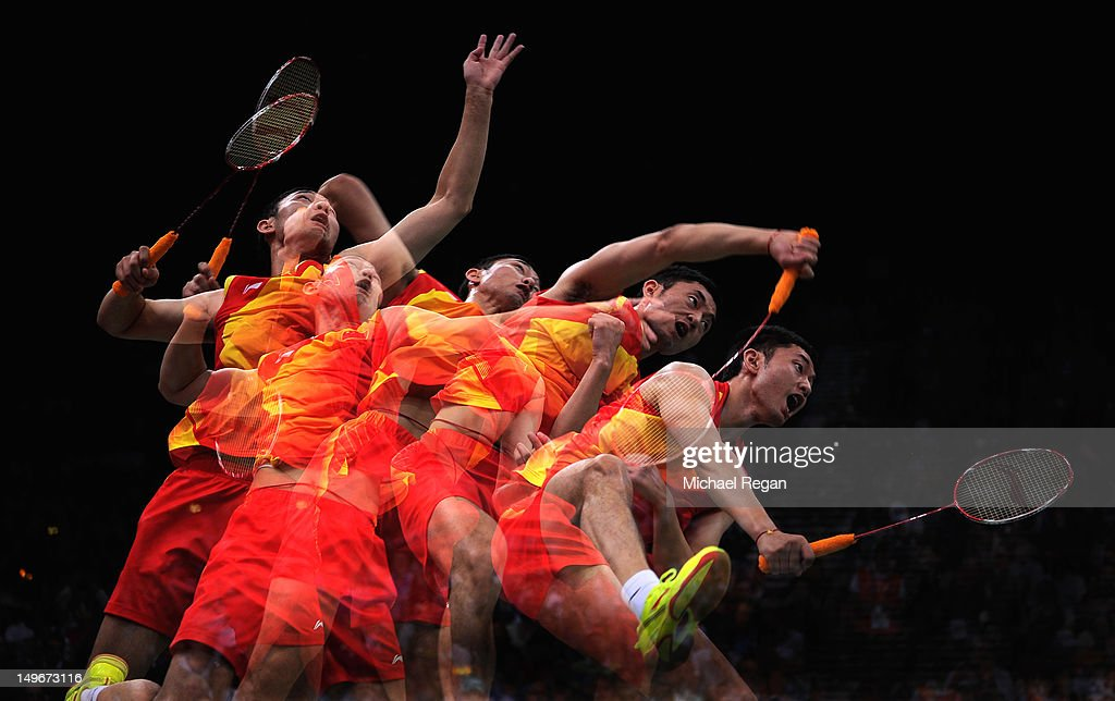 Biao Chai of China returns against Haifeng Fu and Yun Cai of China in their Men's Doubles Badminton quarter final on day 6 of the London 2012 Olympic...