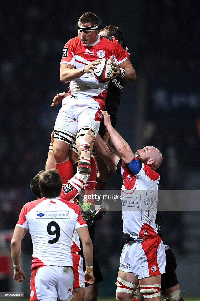 Biarritz' captain Imanol Harinardoquy (C) grabs the ball in a line out during the French Top 14 rugby union match Stade Toulousain vs Biarritz at the Ernest Wallon Stadium, on January 25, 2013, in Toulouse, southwestern France.