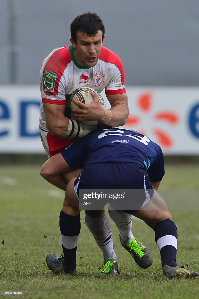 Biarritz's centre Damien Traille (back) vies with Zebre's Ruggero Trevisan during the European Rugby Union H Cup match Zebre Parme vs Biarritz Olympique at the XXV Aprile stadium in Parma on January 12, 2013.