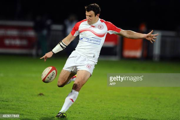 Biarritz's Damien Traille kicks the ball during a French Top 14 rugby union match between Biarritz Olympique and Union BordeauxBegles on November 30...