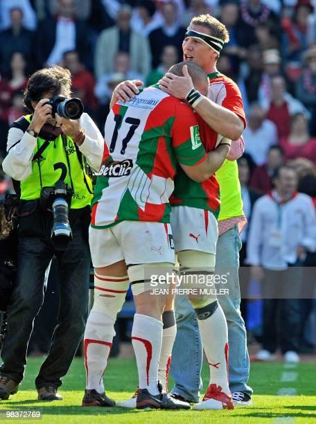 Biarritz's flanker Imanol Harinordoquy congratulates prop Fabien Barcella after their team won 2928 their European Cup quater final match against...