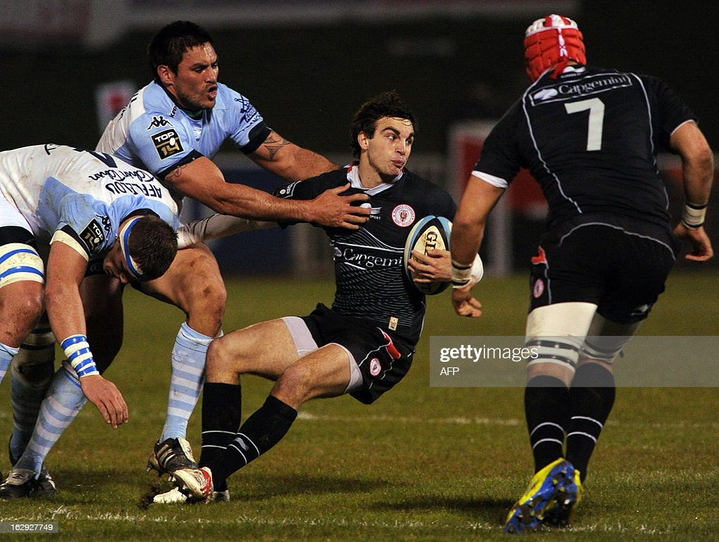 Biarritz's French fullback Jean-pascal Barraque vies with Bayonne's number eight Dwayne Haare (L) during the French Top16 rugby union match Aviron Bayonnais vs BOPB (Biarritz Olympique Pays-basque) on March 1,2013 at the Jean Dauger stadium in Bayonne.