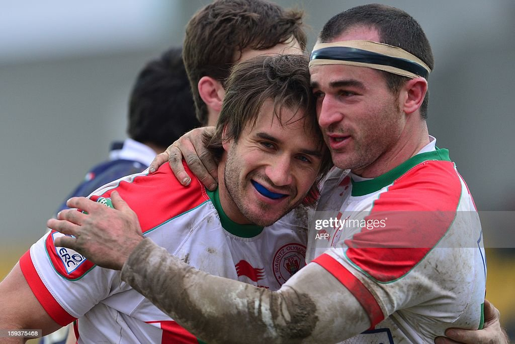 Biarritz's Full back Marcelo Bosch (L) is congratulated by Biarritz's centre Benoit Baby after scoring a try during the European Rugby Union H Cup match Zebre Parme vs Biarritz Olympique at the XXV Aprile stadium in Parma on January 12, 2013.