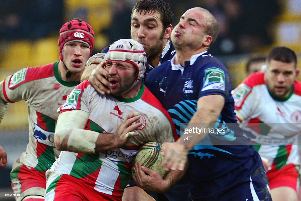 Biarritz's hooker Arnaud Heguy (2ndL) vies with Zebre's Ruggero Trevisan (R) during the European Rugby Union H Cup match Zebre Parme vs Biarritz Olympique at the XXV Aprile stadium in Parma on January 12, 2013.